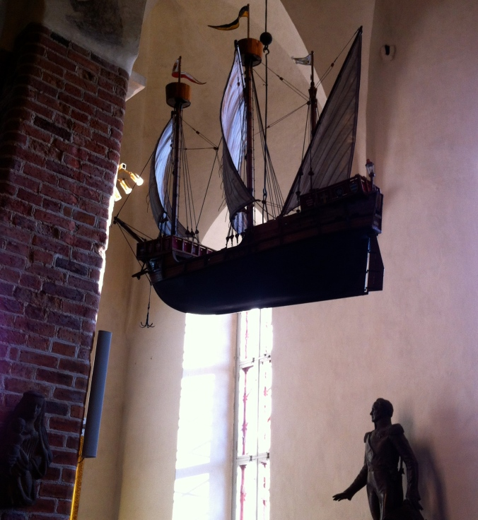A boat hangs inside the church
